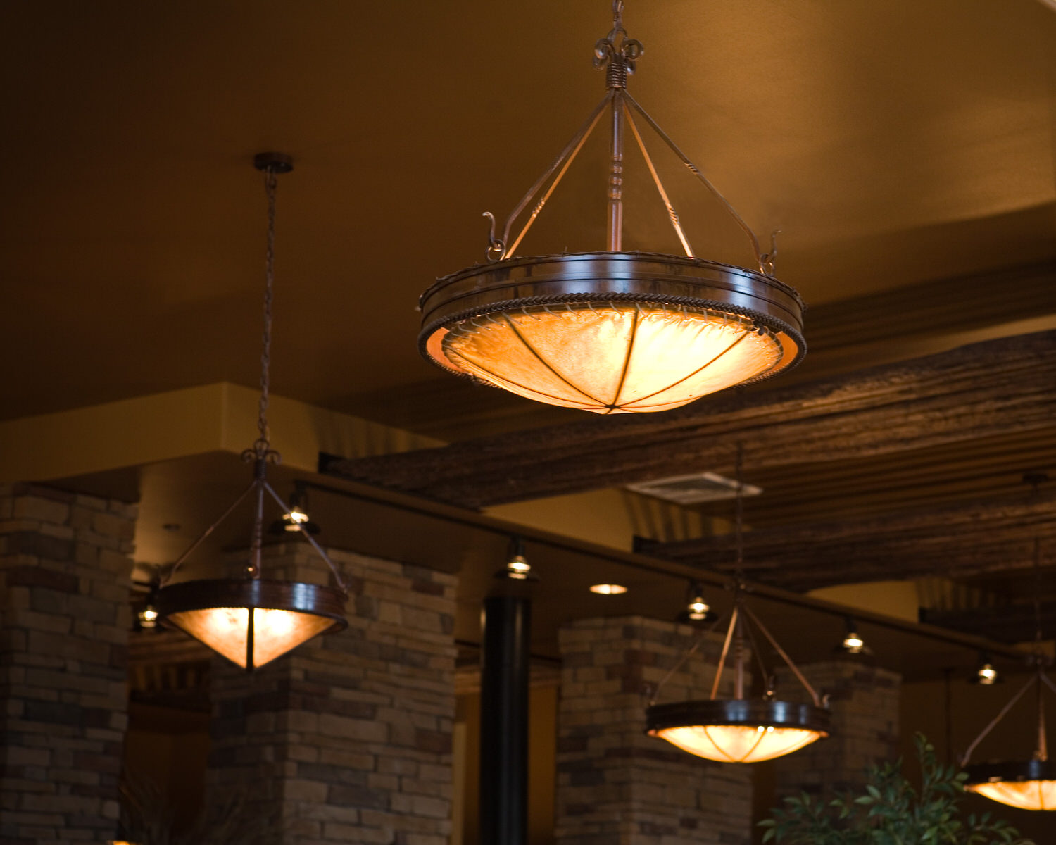 Fire Rock Chandelier With Rawhide Dome Frontier Iron Works